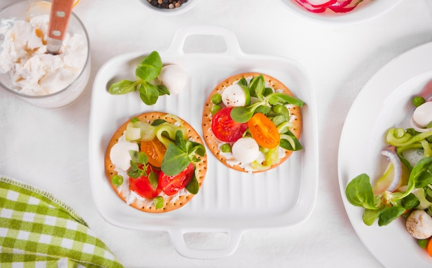 Round crispbread with greens and vegetables. healthy food concept