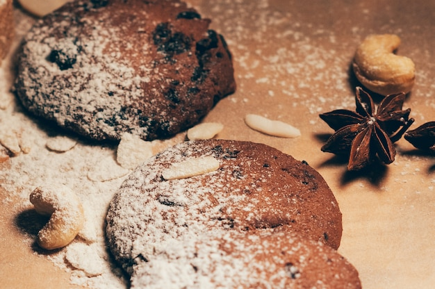 Round crispy chocolate cookies with spices and nuts on a table