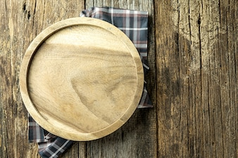 Round cutting board on old wooden,Top view. Copy space.