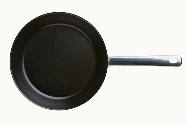 Round empty frying pan isolated on white background. griddle utensils for frying meat or vegetable. top view close up.