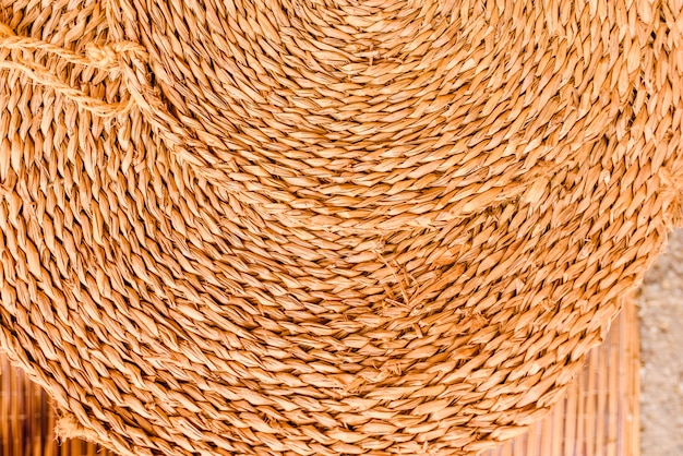 Round esparto mat, natural fiber background.
