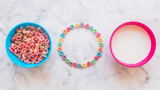 Round frame from cereals with bowls on table