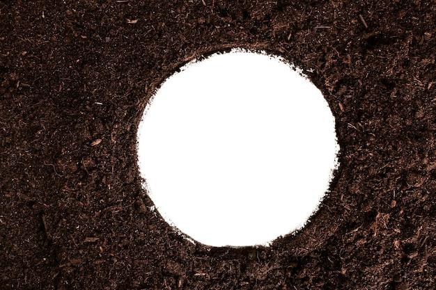 白地に土でできた丸枠