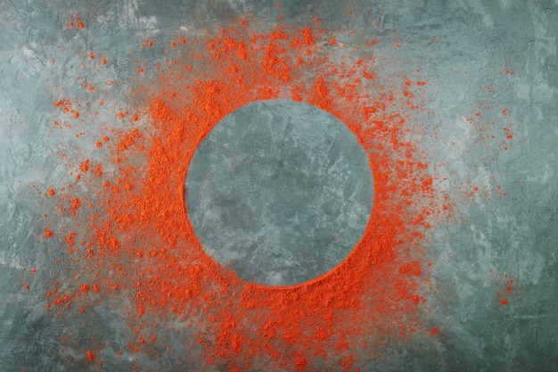 Round frame made of red paprika powder