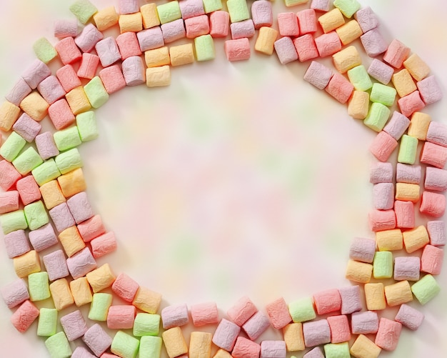 Round frame of multicolored marshmallow