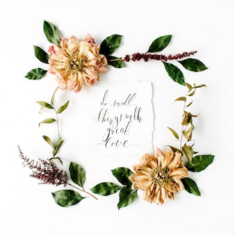 Round frame wreath pattern with inspiration quote written in calligraphy style, beige dried peonies flowers, branches and leaves isolated on white