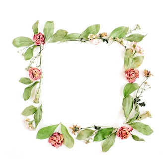 Round frame wreath pattern with roses, pink flower buds, branches and leaves isolated on white surface