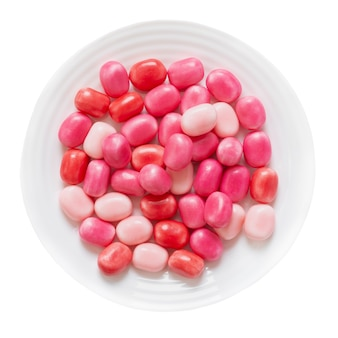 Round fruit gum in a plate isolated on a white background. top view.