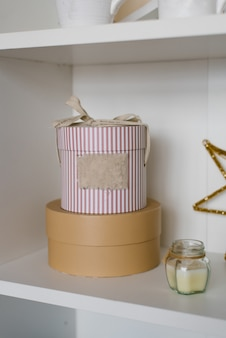 Round gift boxes on the shelf