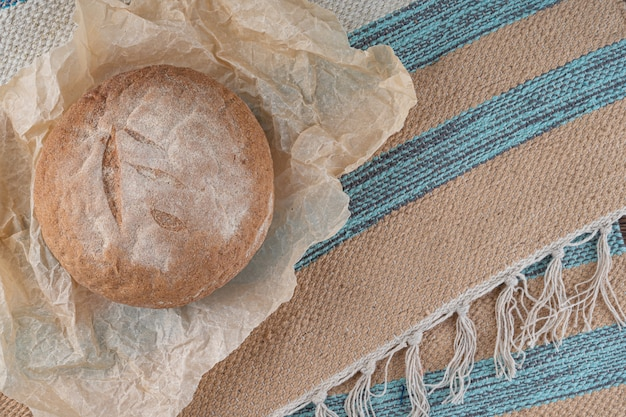 Round homemade bread baked from whole wheat flour.