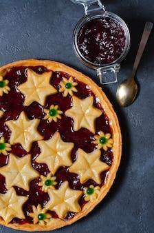 Round homemade cake with plum jam.