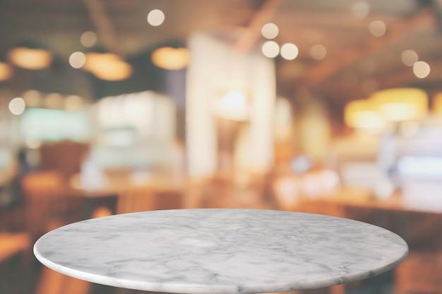 몽타주 제품 디스플레이를위한 카페 레스토랑 bokeh 조명 추상적 인 배경이있는 둥근 대리석 테이블 탑