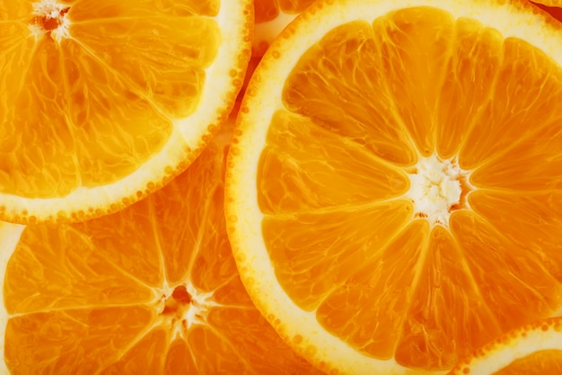 Round orange slices, in the form of texture and lanterns of fresh juicy slices