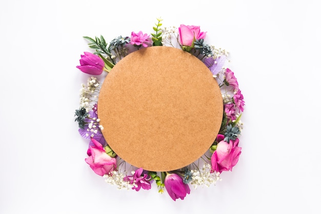 Round paper on different flowers on table