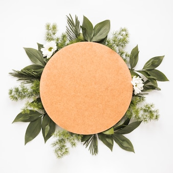Round paper on green plant branches