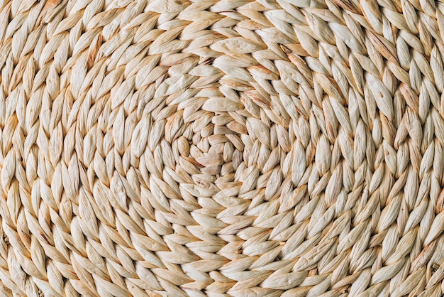 Round pattern from wicker rattan, handmade texture background