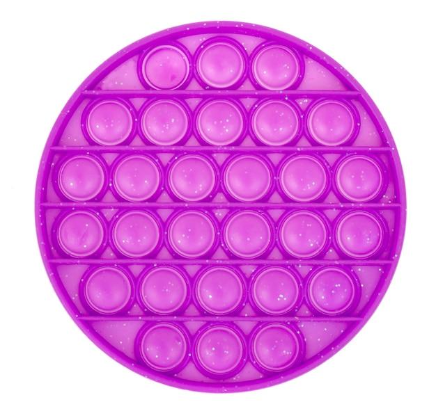 Круглая фиолетовая простая ямочка, выдохни. модная и современная антистрессовая игрушка для детей и взрослых. Premium Фотографии