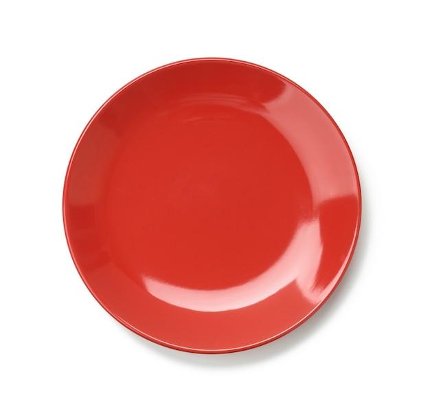 分離されたメインコースの丸い赤いプレート