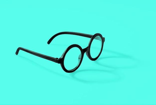 白い背景に影が横たわっている丸い眼鏡