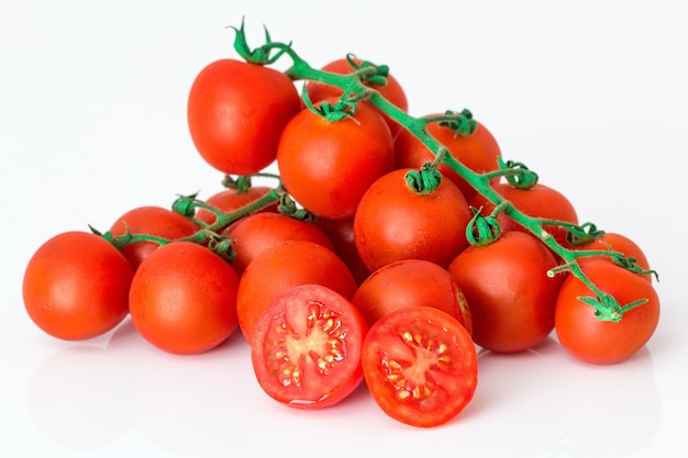 Round tomatoes on top of each other on white