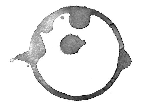 白い背景で隔離のこぼれたコーヒーの丸い痕跡