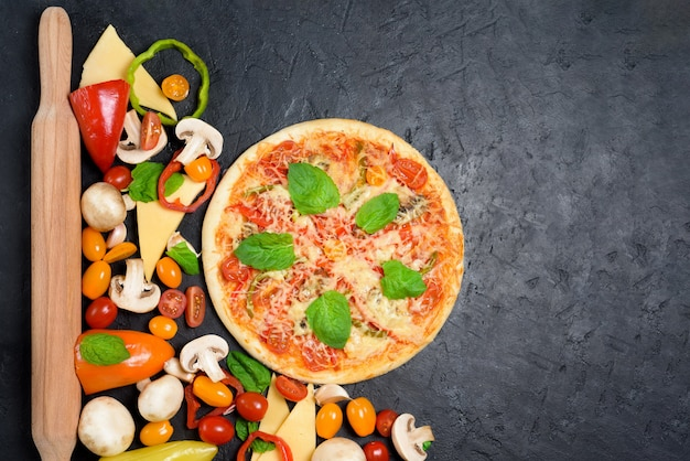 Round vegetarian pizza in the center of the frame.