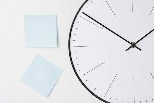 Round wall clock and blue stickers on white