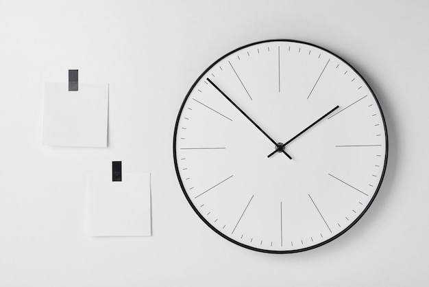 Round wall clock and sticky on white