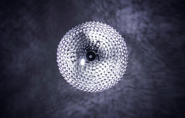 Round white chandelier light with dark background