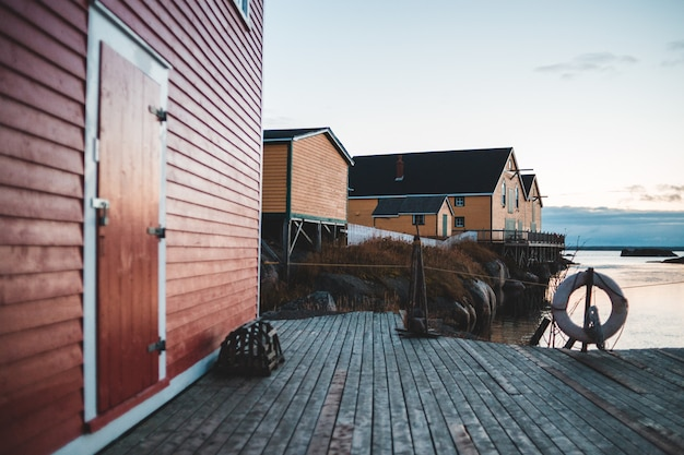 Round white pool ring next to wooden house