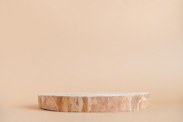 ベージュの丸い木製のこぎりカット表彰台