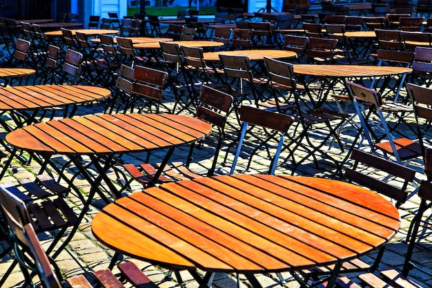 Round wooden table and chairs in line