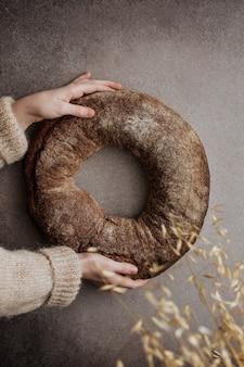 Round yeast-free bread in children's hands.