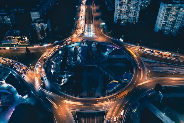 Roundabout in the night city airial shot