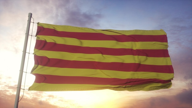 Roussillon flag, france, waving in the wind, sky and sun background. 3d rendering