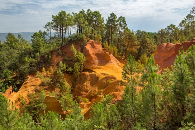 Roussillon ochre quarries under the sunlight and a cloudy sky in france