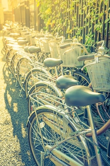 Row of bikes parking ( filtered image processed vintage effect.