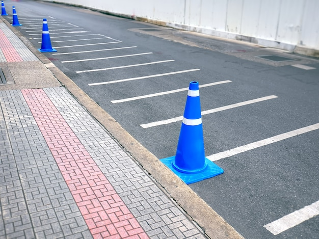 Row of blue traffic cones along the road