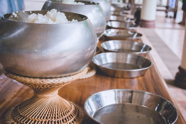 A row on buddhist monk's alms bowl, receive offering food