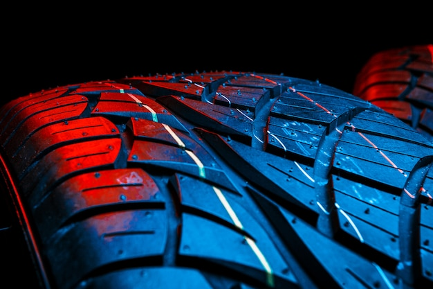 Row of car tires with a profile close-up