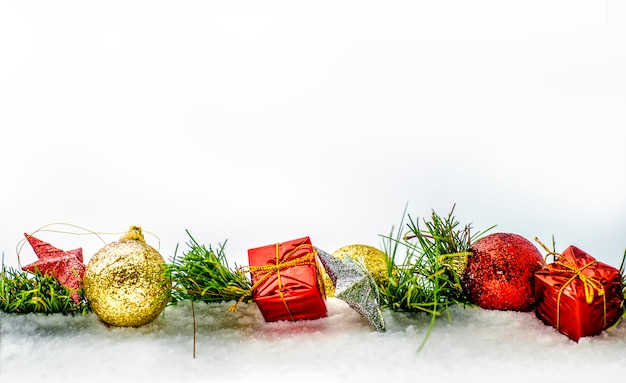 Row of christmas decoration with gift boxes and balls