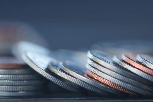 Row of coins on wood background for finance