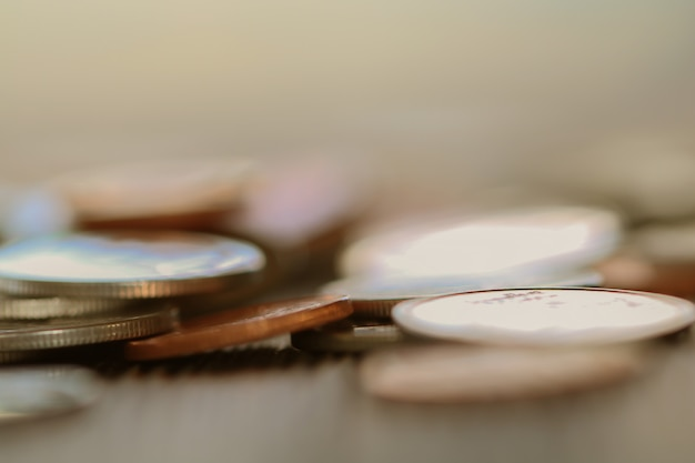 Row of coins on wood background