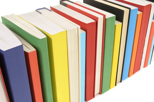 Row of colorful books set against a white background