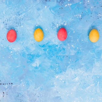 Row of colorful easter eggs on table