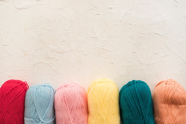 Row of colorful skeins of yarn
