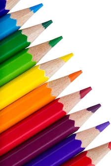 Row of colourful pencils isolated on white
