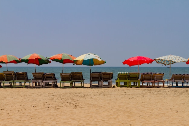Row of covered wooden deck chairs