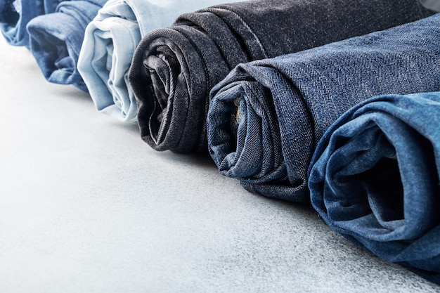 Row of different rolled jeans