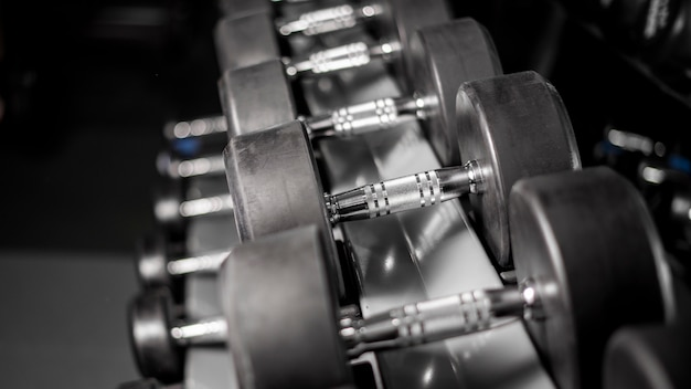 Row of dumbbell in fitness gym